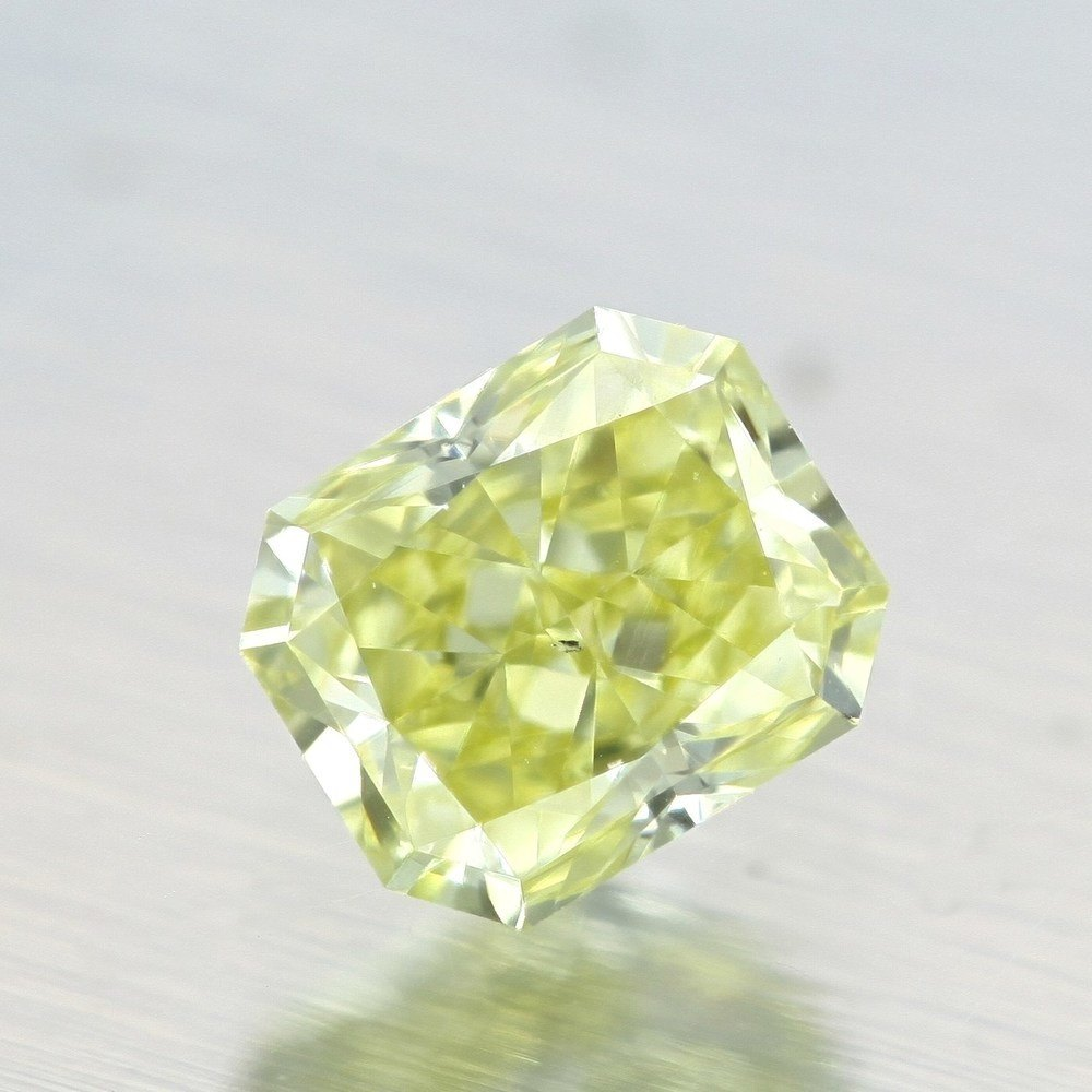 0.57 Carat Radiant Loose Diamond, Fancy Yellow, VS2, Ideal, GIA Certified
